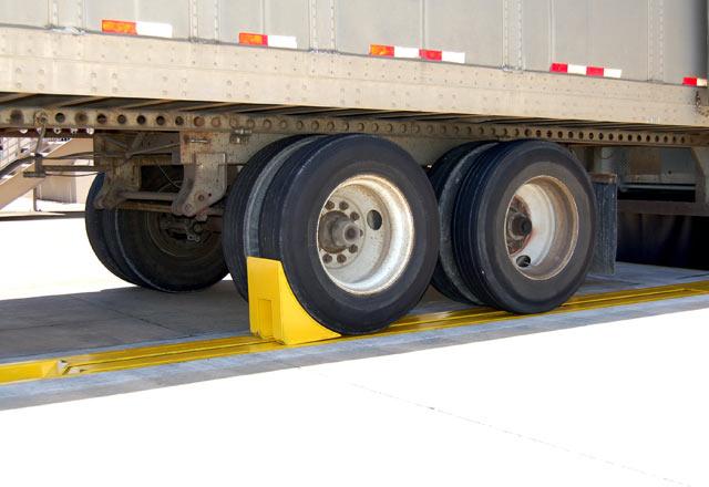 Concrete vs. Rubber Wheel Stops